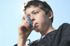 Teen having a asthma problem with sky on the Royalty Free Stock Photo