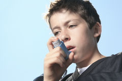 Teen having a asthma problem with sky on the Stock Photos