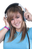 Teen with headphones. Blonde teen with headphones on white background Stock Images
