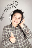 Teen with headphones. Boy with headphones listening to music Royalty Free Stock Images