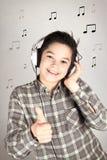 Teen with headphones listening to music. Boy with headphones listening to music Stock Images