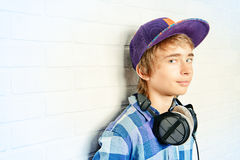 Teen with headphones Royalty Free Stock Images