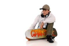 Teen headset skateboard Royalty Free Stock Photo