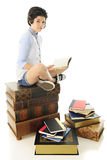 Teen  on a Heap of Books Stock Photo