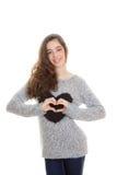 Teen heart shape. Teen making heart shape with brace on teeth Stock Photo