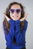 Teen with heart shaped sunglasses Royalty Free Stock Photos