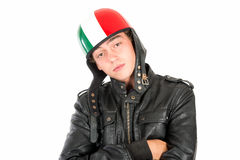 Teen with helmet. Teenager boy with helmet making faces isolated in white Royalty Free Stock Image