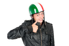 Teen with helmet. Teenager boy with helmet making faces isolated in white Royalty Free Stock Images
