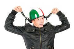 Teen with helmet. Teenager boy with helmet making faces isolated in white Stock Image