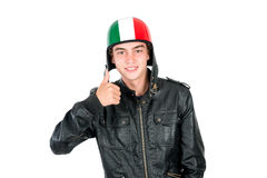 Teen with helmet. Teenager boy with helmet making faces isolated in white Royalty Free Stock Photography