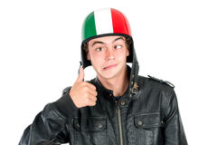 Teen with helmet. Teenager boy with helmet making faces isolated in white Royalty Free Stock Photo