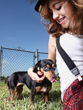 Teen and her dog Stock Images