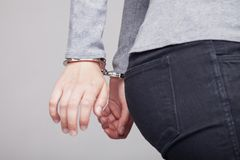 Teen with her hands handcuffed in criminal concept royalty free stock photos