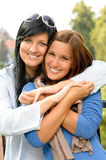 Teen and her mother embracing outdoors bonding Stock Photos