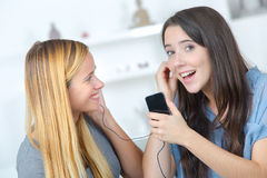 Teen with mother listening music together with complicity. Teen with her mother listening music together with complicity stock photos