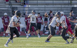 High school football game. Teen highschool football players in a football game stock images