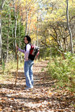 Teen with hiking stick pauses on the trail Royalty Free Stock Images