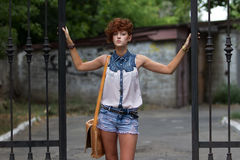 Teen hipster girl posing outdoors Royalty Free Stock Photos