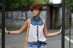 Teen hipster girl posing outdoors Royalty Free Stock Photography