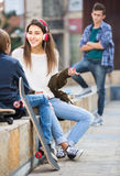 Teen and his friends after conflict outdoors Stock Photo