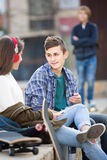 Teen and his friends after conflict outdoors Royalty Free Stock Photography
