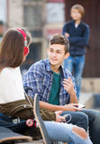 Teen and his friends after conflict outdoors Royalty Free Stock Photos