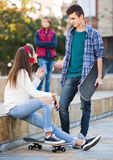 Teen and his friends after conflict outdoors Royalty Free Stock Image