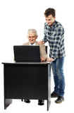 Teen with his granddad at laptop Stock Photography
