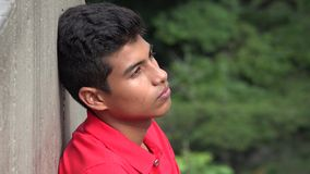 Teen Hispanic Boy Contemplative Silent And Alone Royalty Free Stock Images