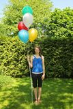 Teen holding baloons Royalty Free Stock Photos