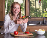 Teen holding a big sandwich Royalty Free Stock Photo