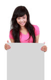Teen holding on blank board Stock Photography