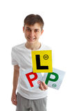 Teen holding driving licence plates for car Stock Photography