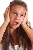 Teen holding ears Stock Image