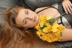 Teen holding a flowers Royalty Free Stock Photos