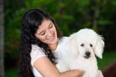 Teen holding a french poddle dog Royalty Free Stock Photos