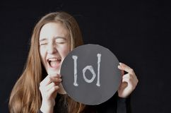 Laugh out loud. Teen holding lol sign and laughing Royalty Free Stock Photography