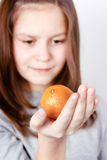 Teen holding in the palm of mandarin Royalty Free Stock Photo