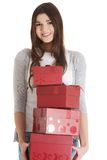 Teen holding presents Stock Photography
