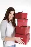 Teen holding presents Royalty Free Stock Photos