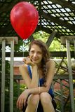 Teen holding a red balloon Royalty Free Stock Photography