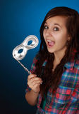 Teen holding a silver mask Stock Photography