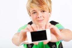 Teen holding smart phone Stock Photo