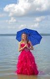 Teen holding umbrella long prom dress Stock Photo