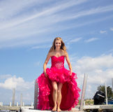 Teen holding up prom dress Royalty Free Stock Photography