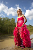Teen holding up prom dress Stock Image