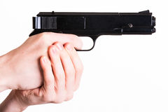 Teen holds a handgun Royalty Free Stock Photography
