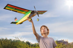 Teen with homemade radio-controlled model Stock Image