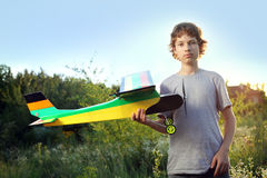 Teen with homemade radio-controlled model aircraft Royalty Free Stock Photo