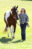 Teen with horse. Cowgirl walking her beautiful horse Royalty Free Stock Photos
